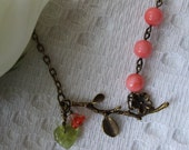 Antiqued Flower Branch Pendant Necklace with Orange Beads and leaf Charms