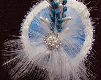 Blue Baby, blue satin, rhinestone brooch, pearls, fluff feathers