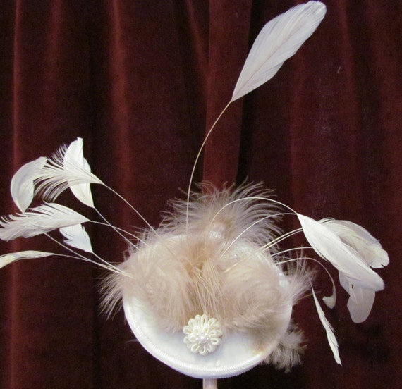 Whispy, white velvet base and trim, delicate satin flower, buff fluff feathers, white stripped feathers