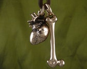 Anatomical Heart and Femur Bone Necklace Bronze Pendant on Leather - The Human Condition