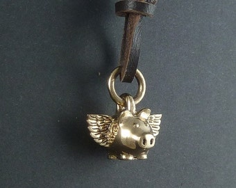 Flying Pig Necklace Bronze Flying Pig Necklace on Leather