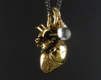"Anatomical Heart Necklace 24 Karat Gold Plated Heart Pendant with 14 Karat Gold Filled Wire Wrapped Quartz On 24"" Gunmetal Chain"