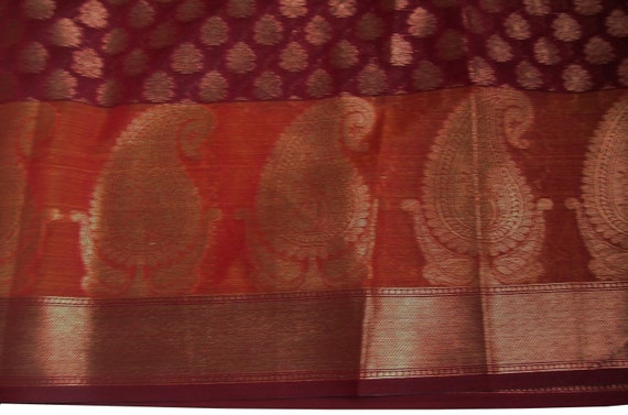 Half yard red and gold chanderi cotton silk with a gorgeous paisley motif border