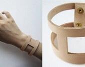 Hand cut leather cuff