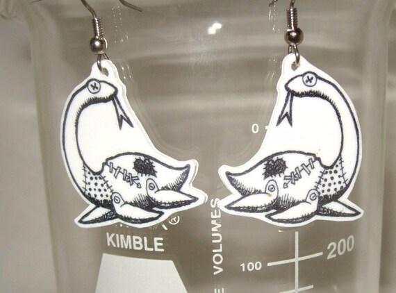 rag doll Nessie earrings original artwork black and white cryptid sea creature prehistoric Loch ness monster