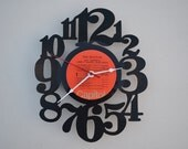 Handcrafted vinyl record clock (artist is The Beatles)