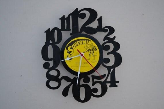 vinyl record clock (artist is Superman)