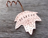 "Autumn maple leaf ornament made from copper, stamped with ""Believe"""