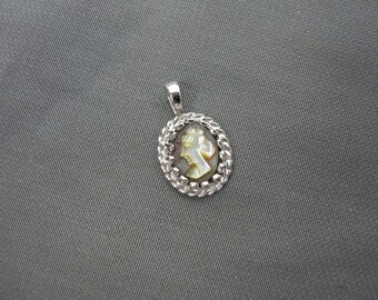 Vintage silver tone cameo pendant
