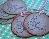 "6 Kraft Paper Hand Stamped 2"" Holiday gift tag for Christmas Presents featuring a snowman on a red and green glittered edge"
