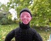 Grimacing Doll