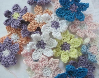 10 crocheted daisies in assorted colours