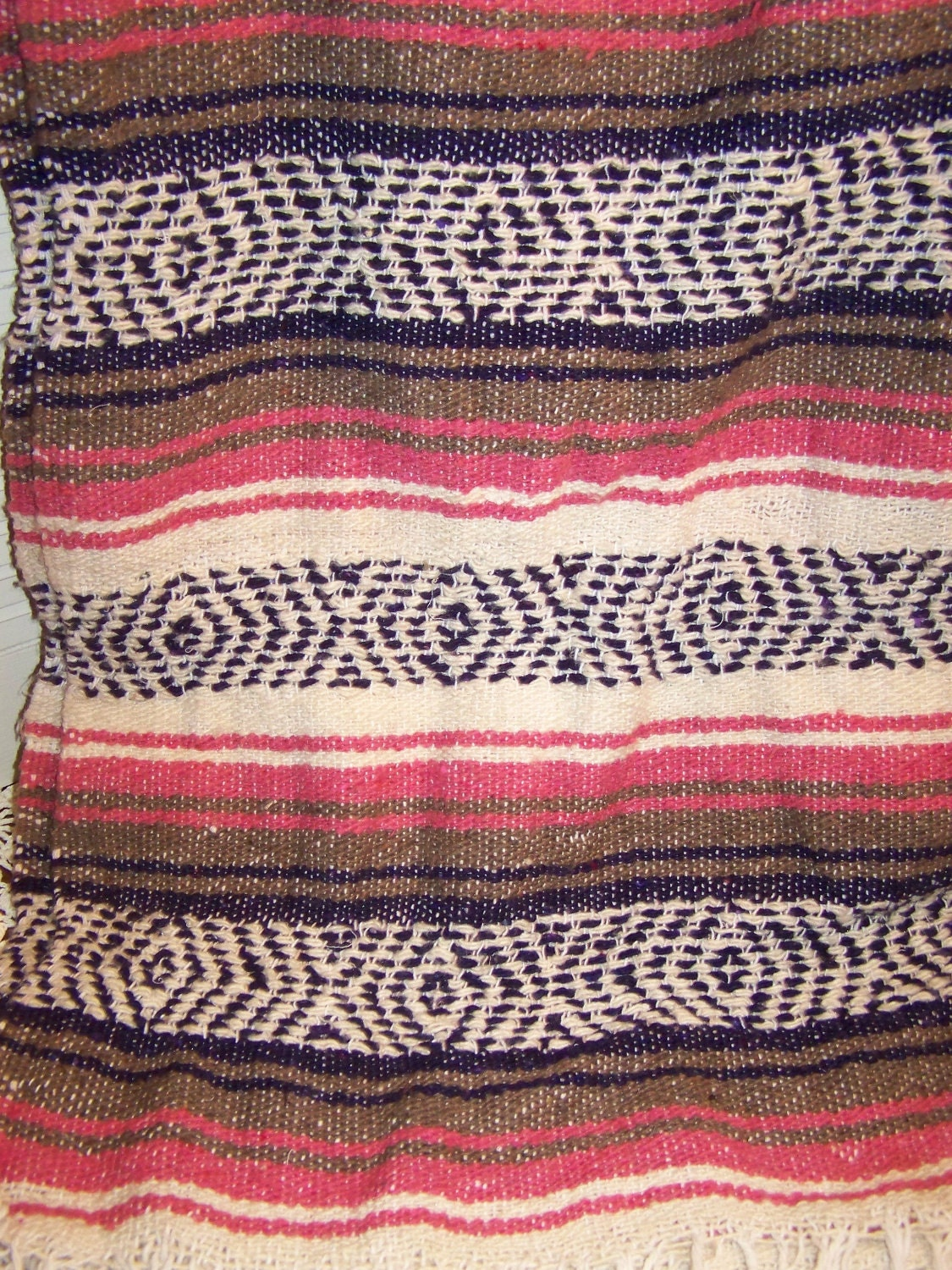 Vintage mexican blanket own, playing