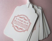 """Set of 10 stamped tags with string -- """"uniquely handmade"""""""