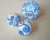 Pair of blue and purple swirl button earrings with matching ring
