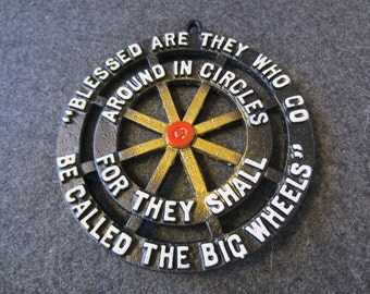 Blessed are they who go around in circles for they shall be called big wheels vintage metal trivet wall hanging kitschy
