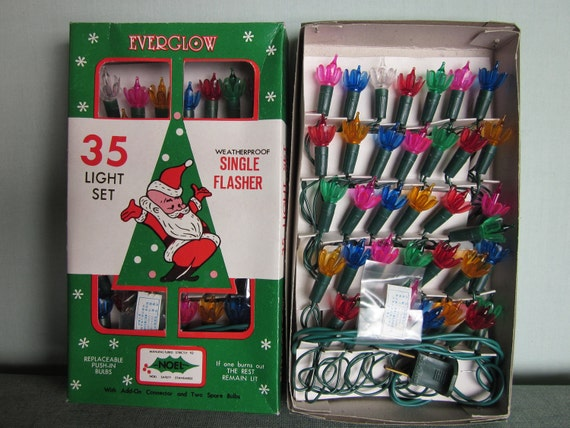 RESERVED Vintage Christmas lights with flower shaped reflectors mutlicolor 2 35 light sets new in box but don't work