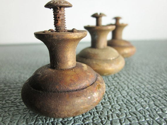 Three vintage brass or brass colored knobs drawer pulls with hardware