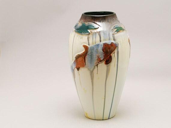 Carved koi fish vase on white crystalline porcelain by kyle for Koi fish vase