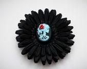 Black gerber daisy hair clip with skull cameo