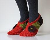 Beautiful hand knit wool slippers with decorative crocheted button added