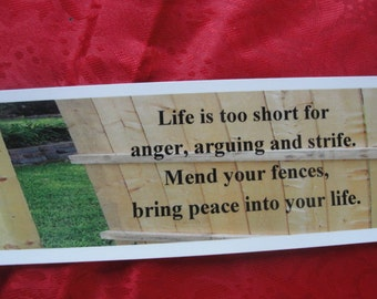 "Bookmark titled ""Mend Your Fences"""
