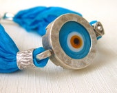 Silk and Silver Wish Bracelet with blue evil eye bead