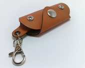 Extremely convenient keychain key holder from orange cowhide. Holds 6-8 keys, free monogramming , personalized , belt hanger
