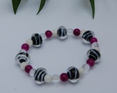 Black and white lampworked, violet glass, and mother of pearl bracelet