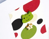 Card: Blank Greetings Card with Wooden Frog and Bright Spot Design