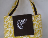 Embroider quilt purse in yellow floral with brown flap with monogram
