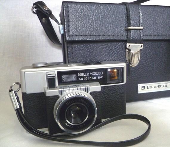 Vtg Rare 1950s Bell and Howell Autoload 341 126 film Camera by Canon. Original case, hand strap, neck strap, dessicant. Auto Load.