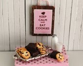 """Miniature Chocolate Chip Cookies And Brownies On A Silver Tray And A Cute Wall Hanging That Says """"Keep Calm And Eat Cookies"""""""