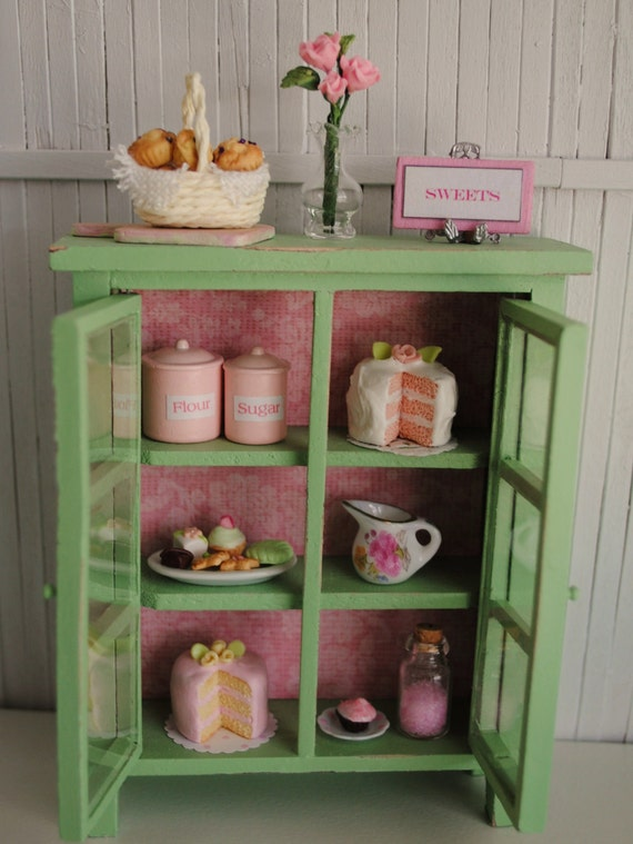 Miniature Green Shabby Chic Kitchen Cabinet Filled With Cakes, Canisters, And Lots Of Goodies