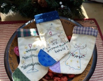 Set of three Primitive Christmas stocking ornies bowl fillers gift bags or tree ornaments