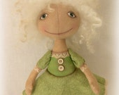 OOAK  handmade cloth art primitive doll in green with a dog.