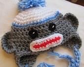 Sock monkey hat with blue trim (0-3 mon)