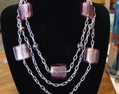 purple glass with silver plated wire