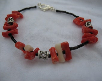 Red and white coral bracelet