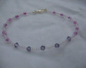 Purple crystal and glass beads bracelet