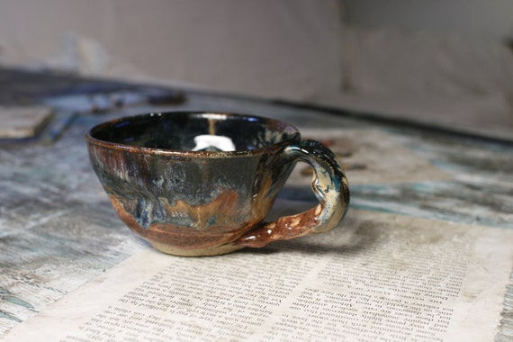 small altered earthy teacup