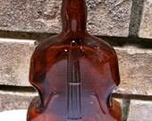 Vintage violin glass bottle vase amber color