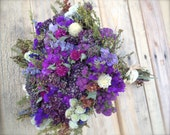 Dried flower bouquet in purples with a touch of cream and bronze.  All natural.