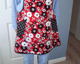 womans vibrant full apron - red,black, and white floral