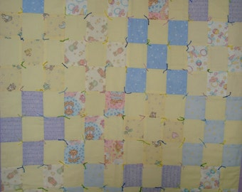 Beautiful quilted baby quilt in nine patch pattern