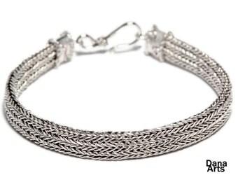 Flat woven silver bracelet