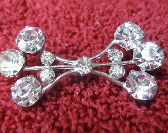 "Vintage jewelery. Rhinestone brooch, shaped like a bow. 2"" ins long.  Very elegant.   VFM12.2-11.8."