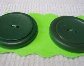"""2 Large dark green buttons, 2 hole, 1.25"""" inches across. Simple design, very effective. Great  condition.   VFM/S12.1-6."""
