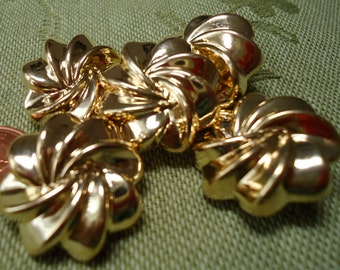 "5 vintage gold toned swirl buttons, metal. self shank. 1"" in across.  UNK12.3-5.5,"