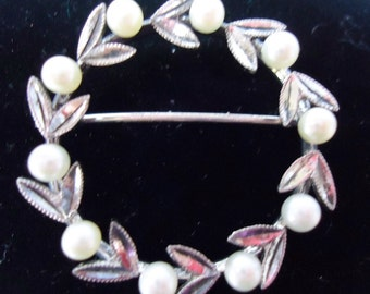 """Vintage silver and pearl round pin with good working safety catch. 1.25"""" diameter.   CLSLVA12.3-15.1."""